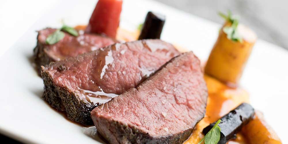 Sous-vide Canadian Elk Strip Loin, Rainbow Carrots, Carrot Cream & Allspice Gastrique