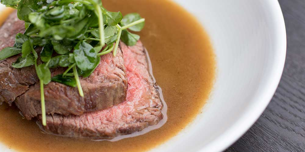Grass-Fed Angus Tri Tip with Savory Yuzu Butter & Pea Shoot Salad