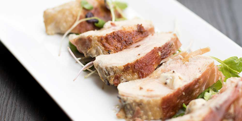 Prosciutto-Wrapped Guinea Fowl Breasts with Black Truffle Butter & Microgreen Salad