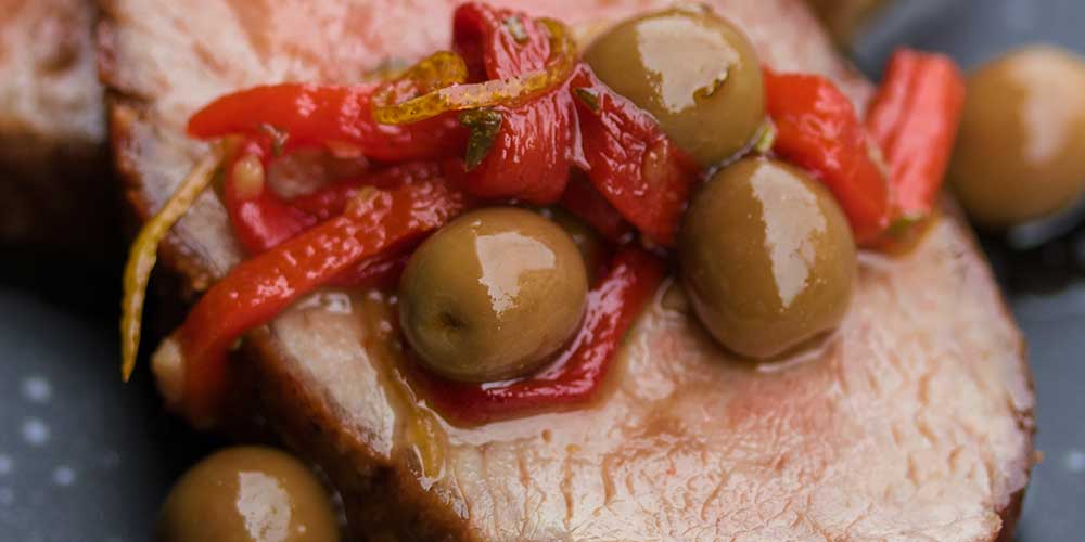 Iberico Pork w/ Garlic, Olives & Peppers